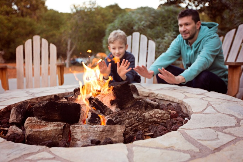 Father and Son Having Bonfire