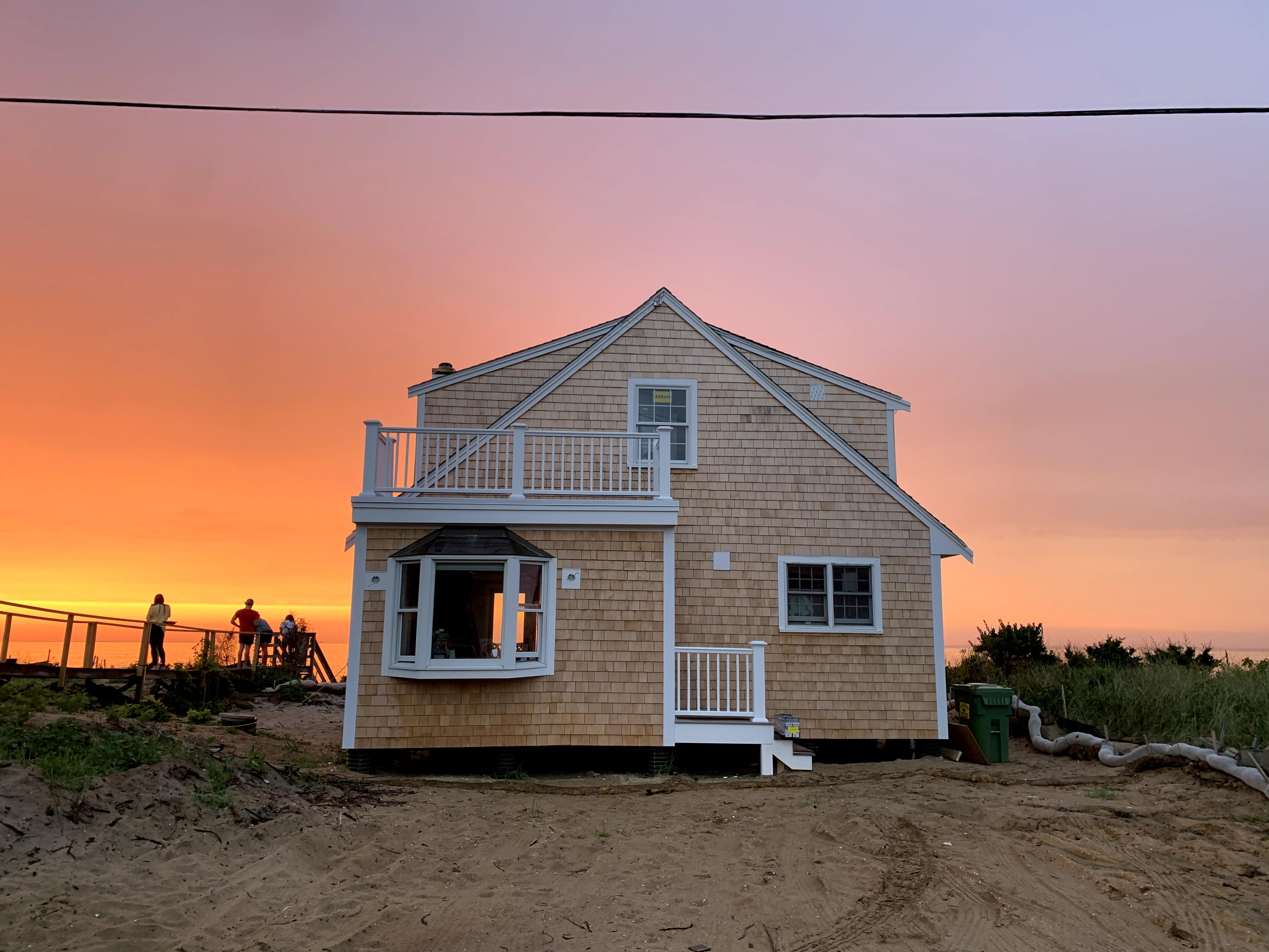 House on Cape Cod Bay with sunset