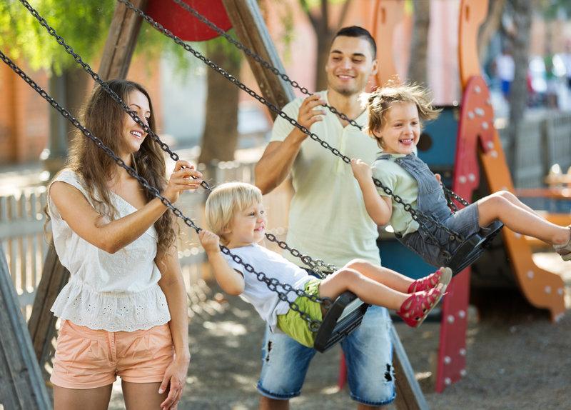 Family on Swing Set