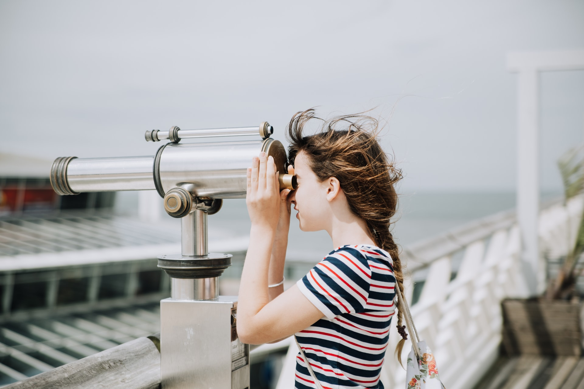 woman looking through spyglass