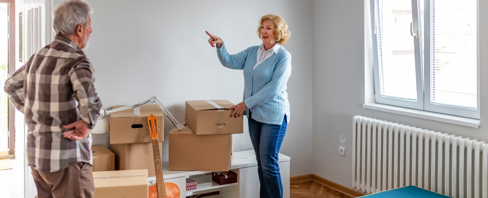 Senior man and women with moving boxes downsizing