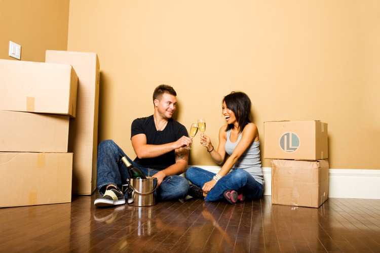 First time home buyers celebrating move