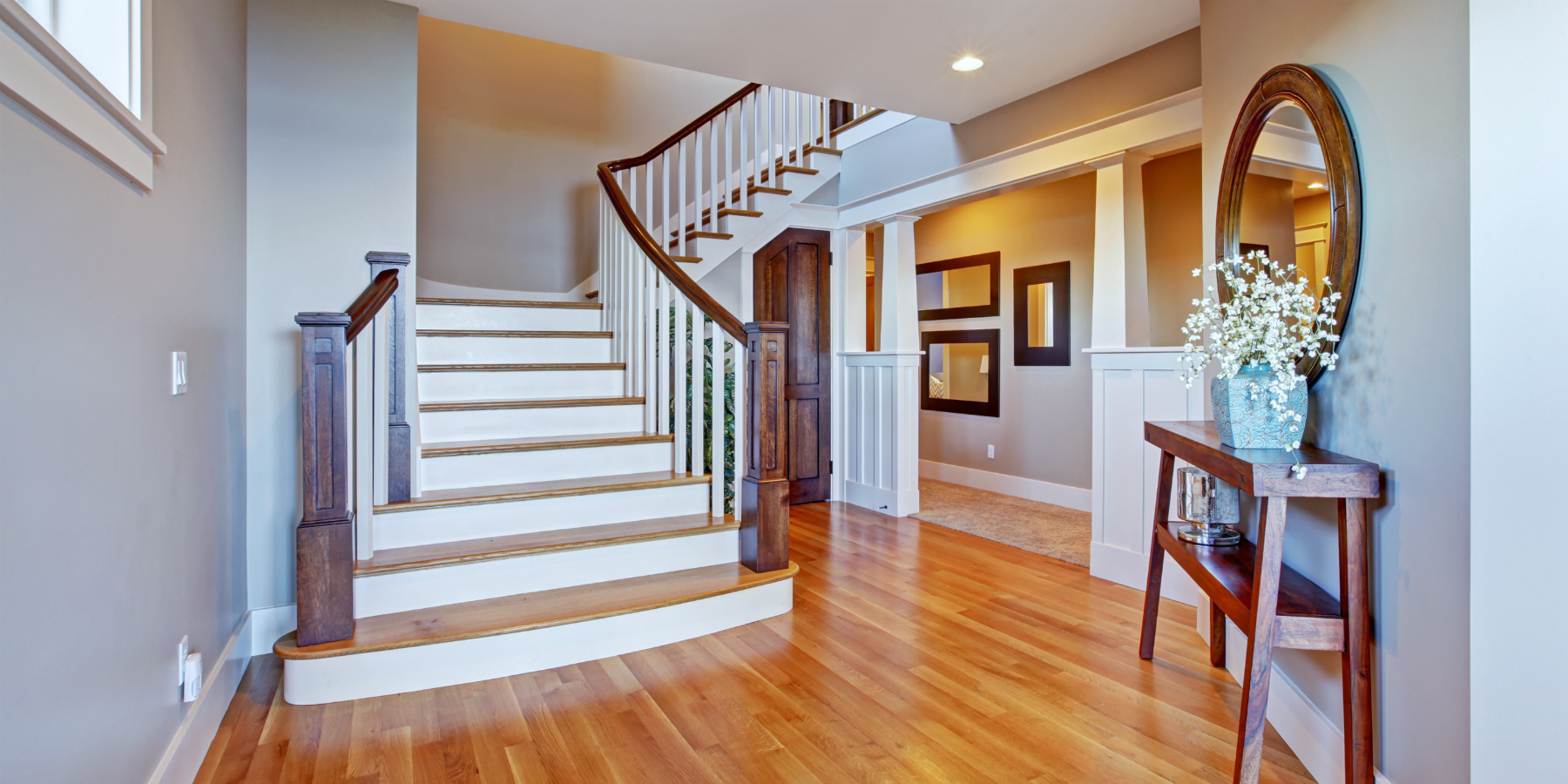 Entrance foyer with staircase and wood floor