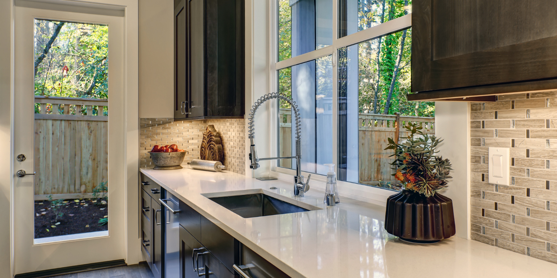 Contemporary kitchen with chrome faucet and brown cabinets