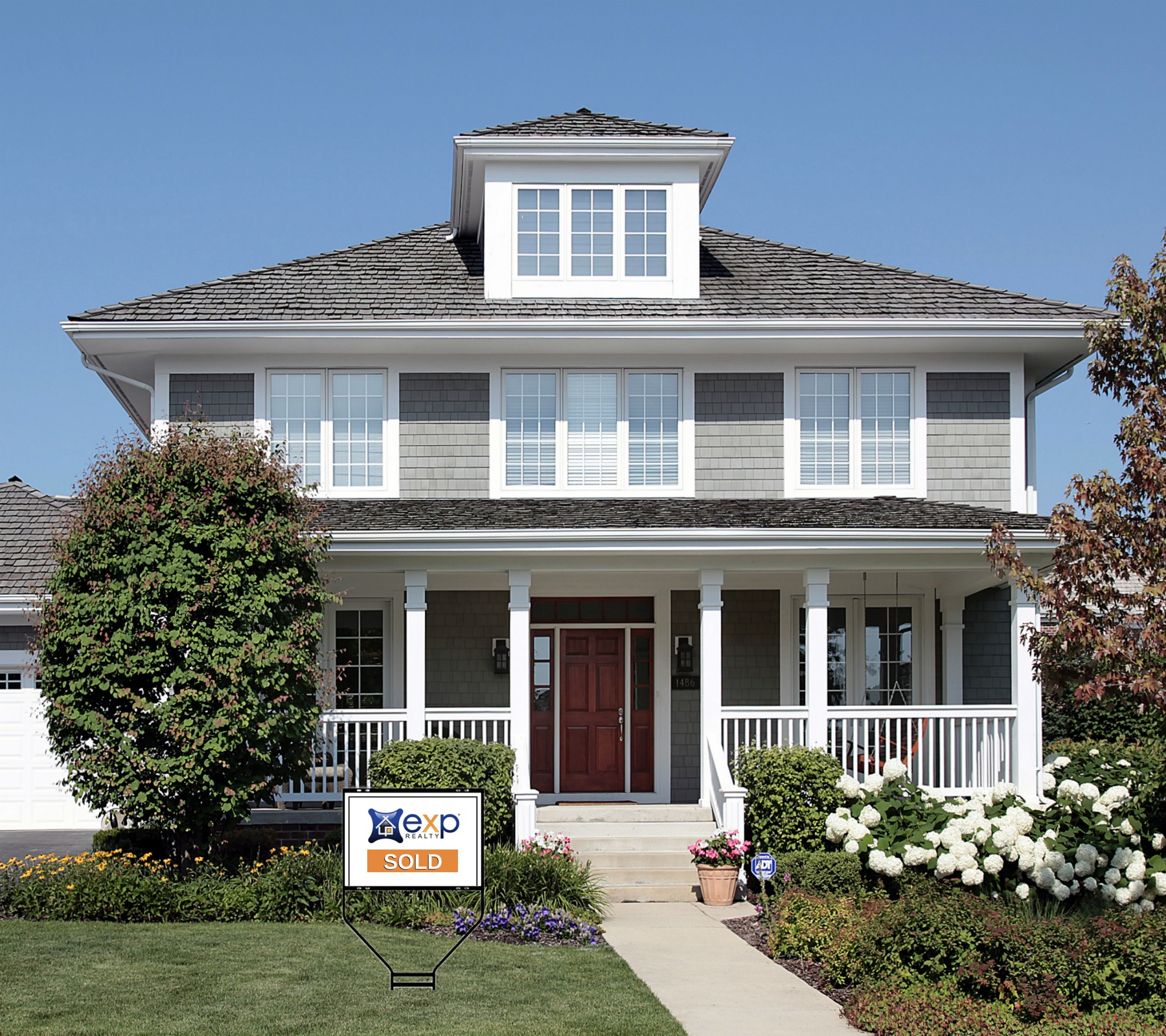 Gray craftsman house with eXp sold sign