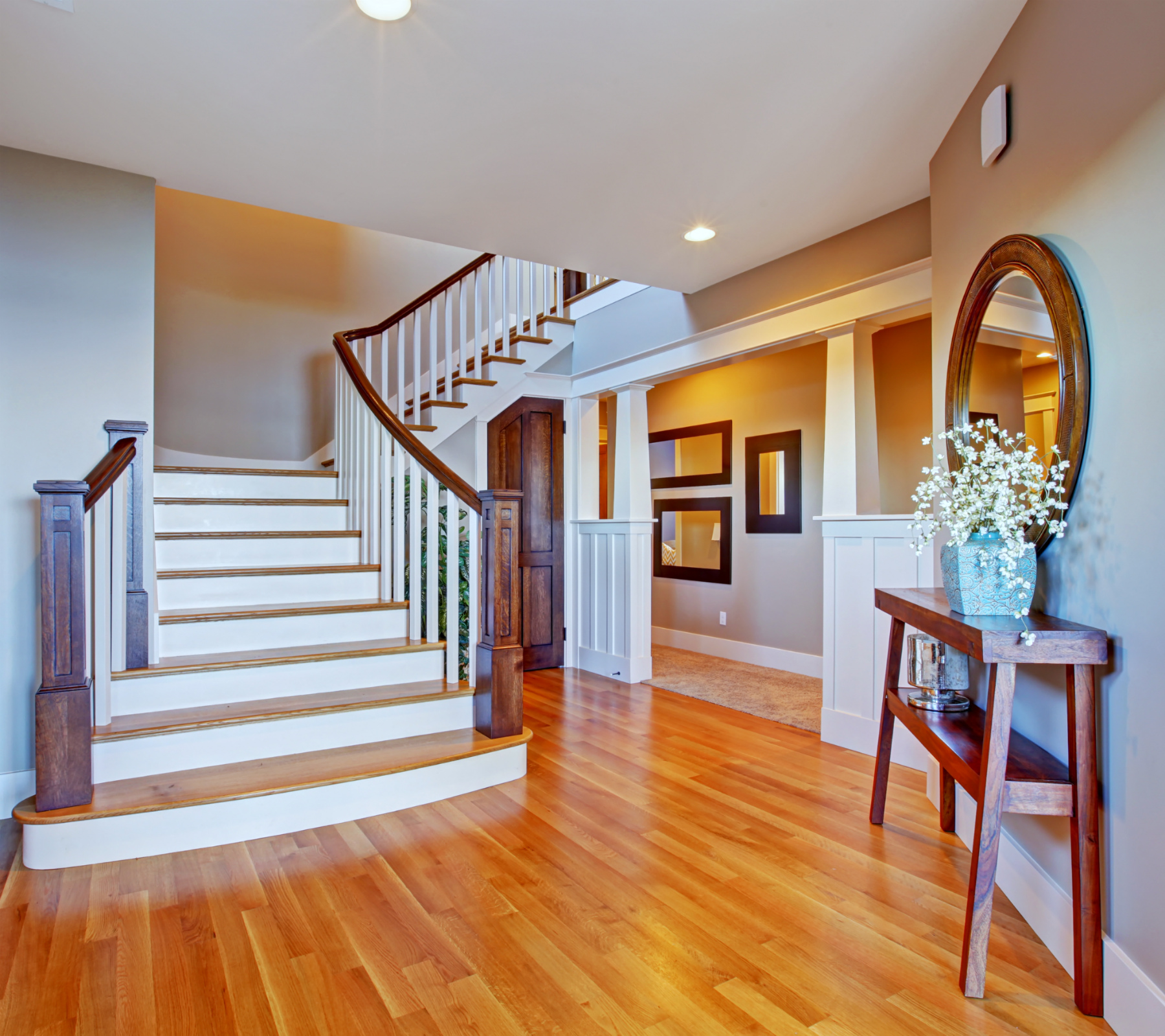 Foyer gray walls staircase and hardwood floors