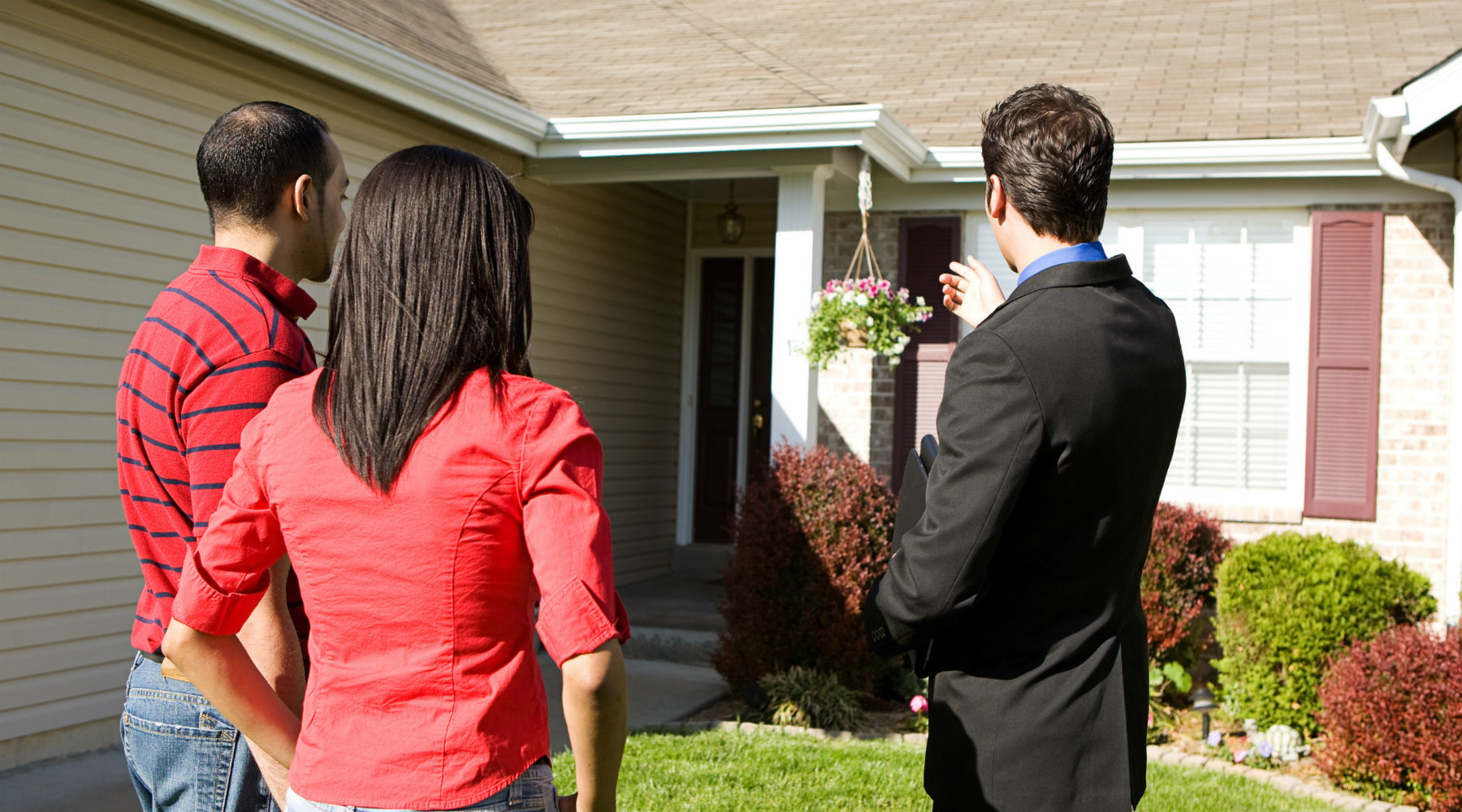 Agent showing home to man and woman
