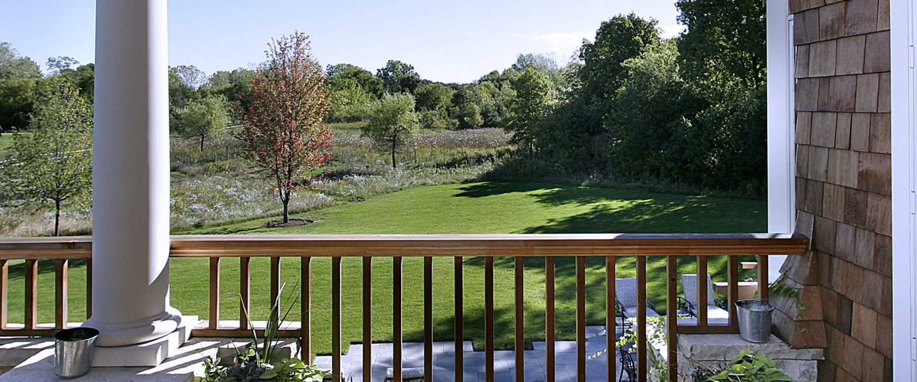 Rear deck overlooking green area BRIX Group