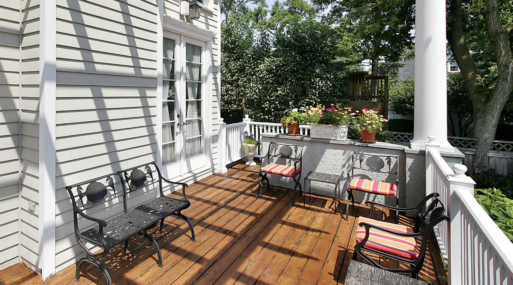 Deck with wrought iron furniture and flowers