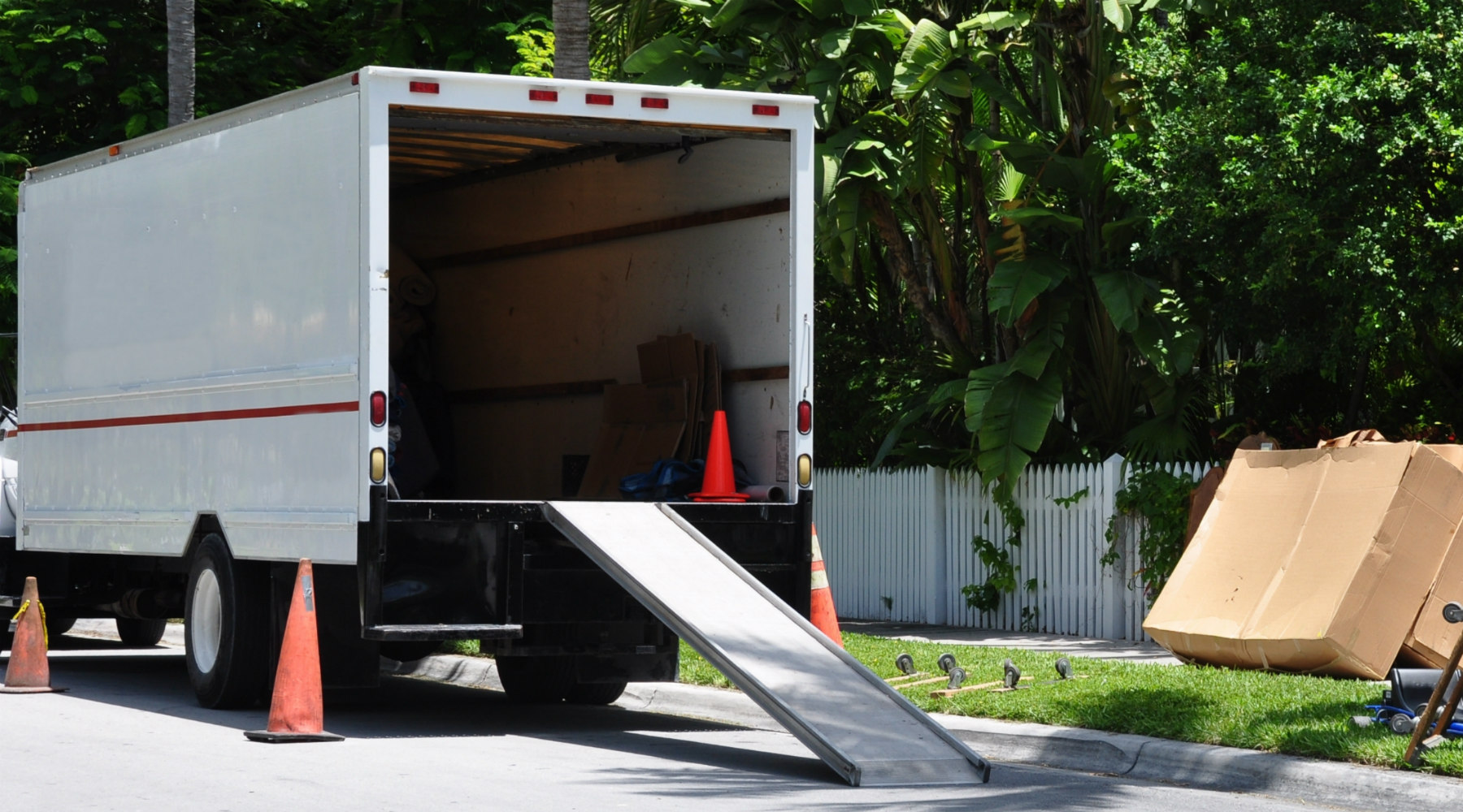 Moving truck with ramp and boxes