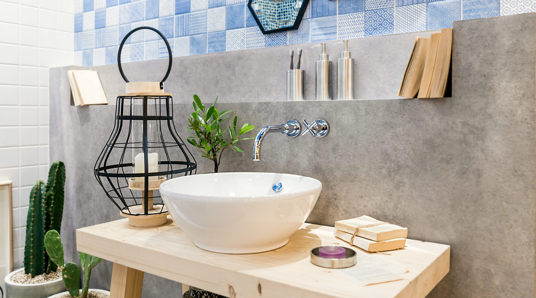 Bathroom with blue tile and white vessel sink
