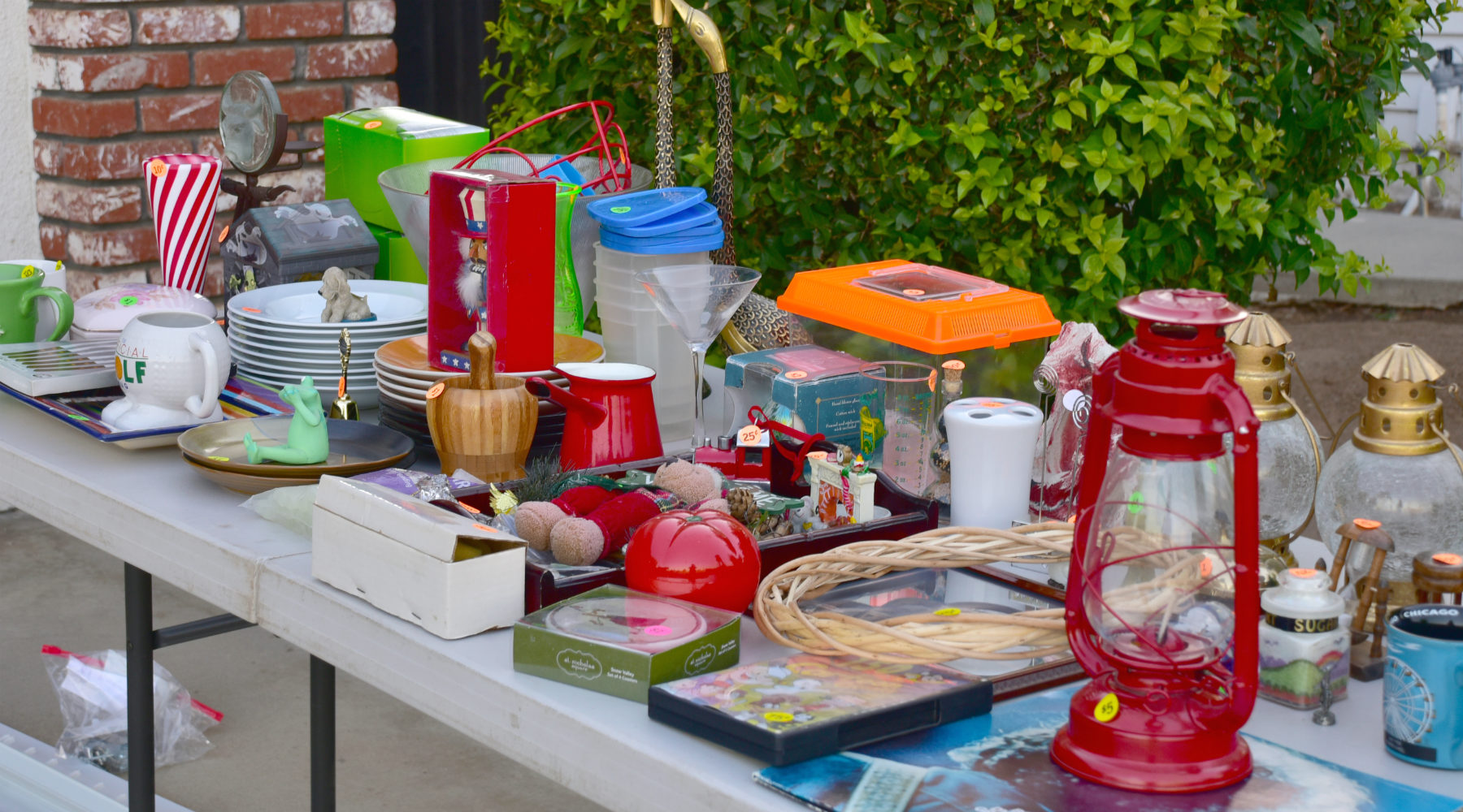 Garage sale table with dishes and glasses
