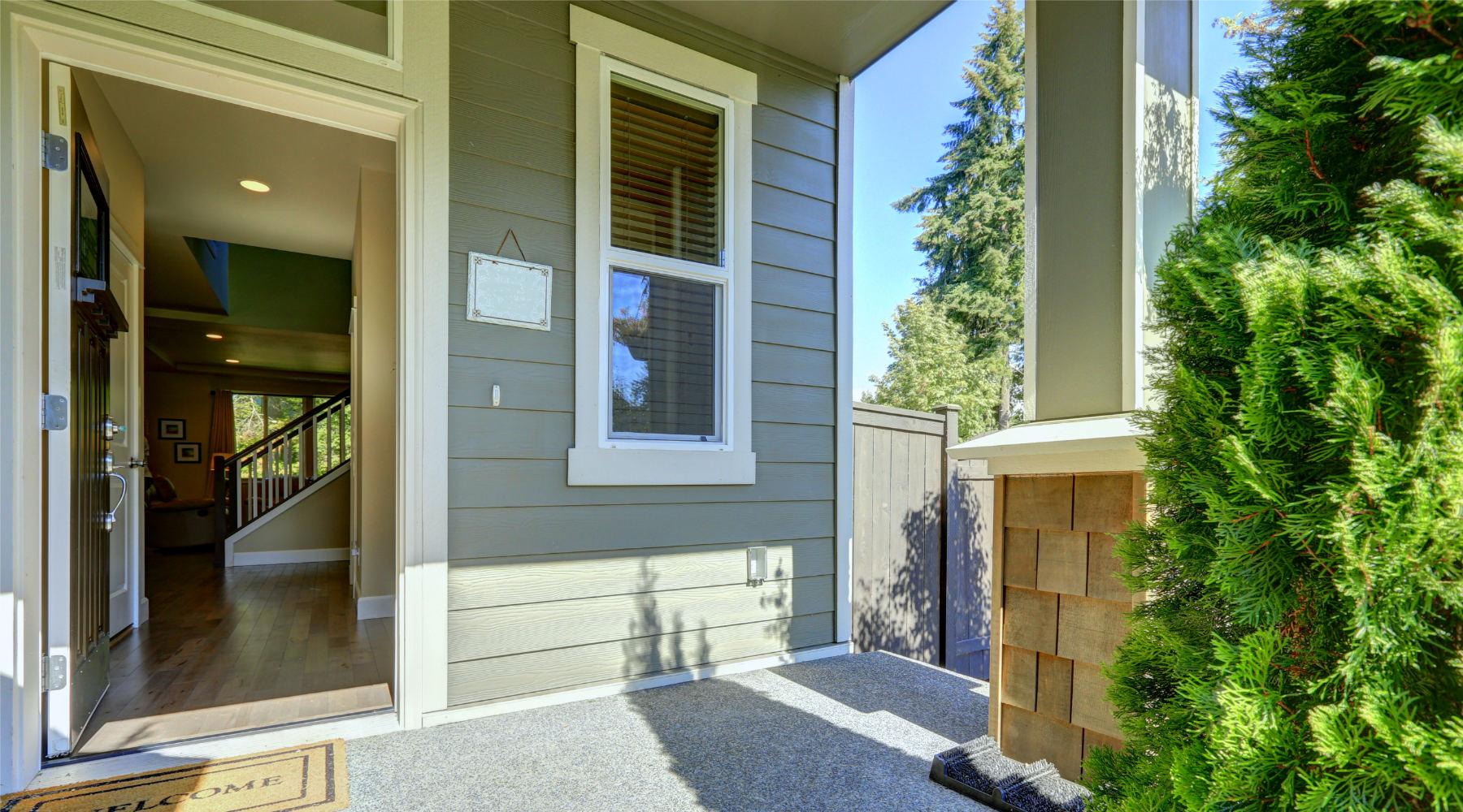 Front porch open door gray green house 1800x1000