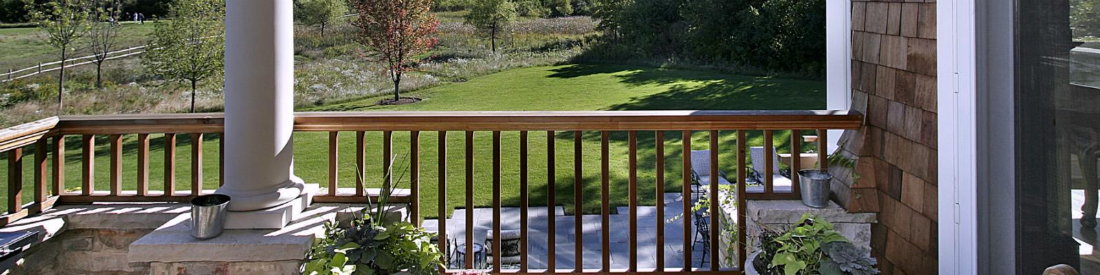 Rear deck overlooking green area