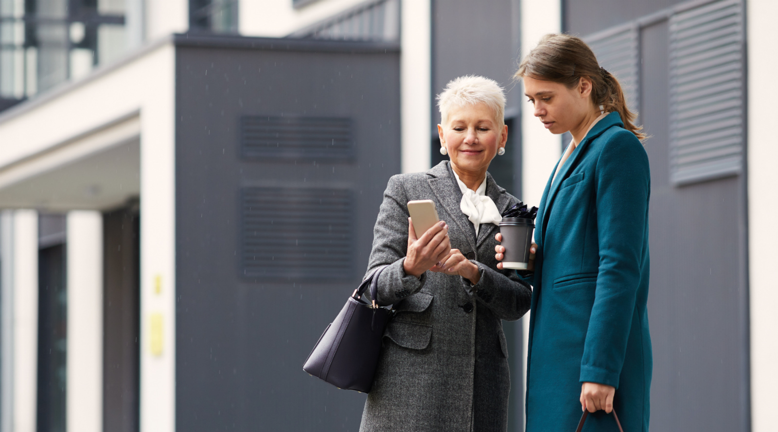 Two women looking a smart phone
