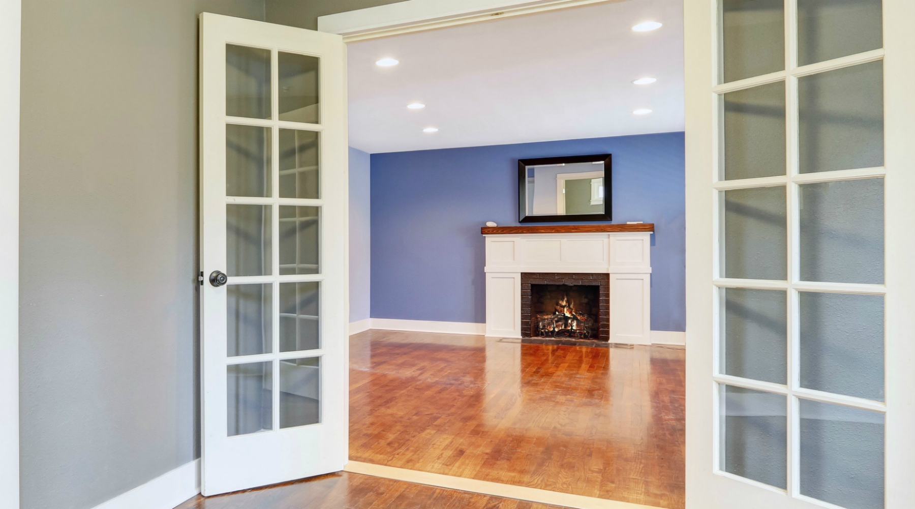 French doors opening to living room