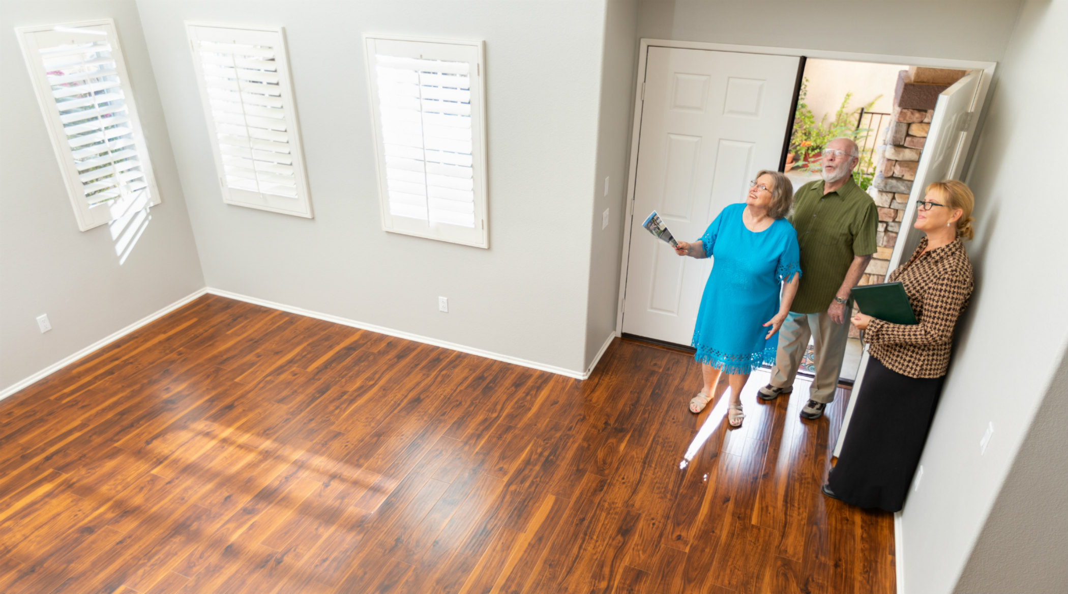 Agent showing home to older couple