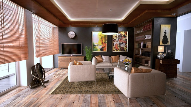 living room with wood floors and 2 couches