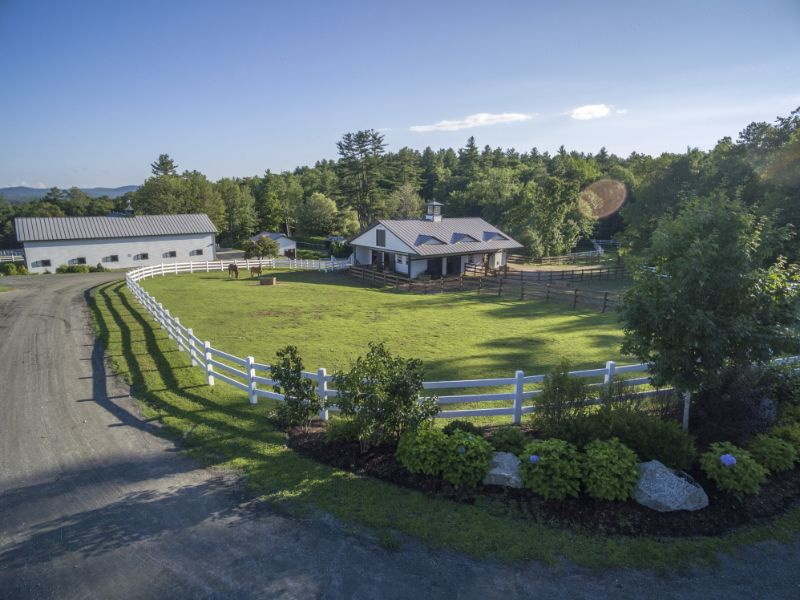open farm land with property
