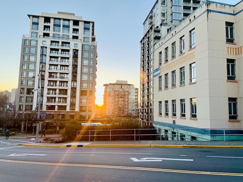 Sun setting between buildings in Victoria