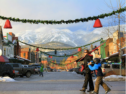 downtown with snow capped mountains in background