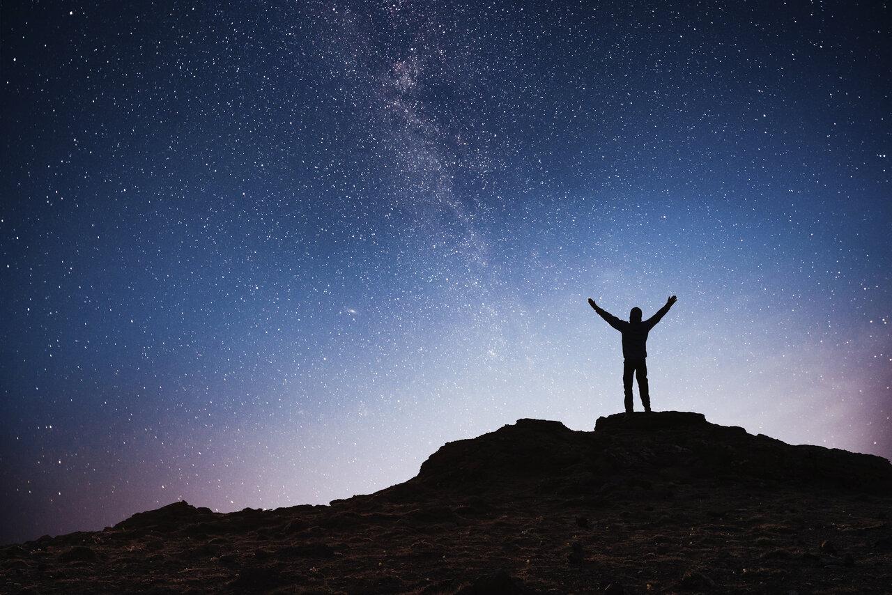 person standing under stars