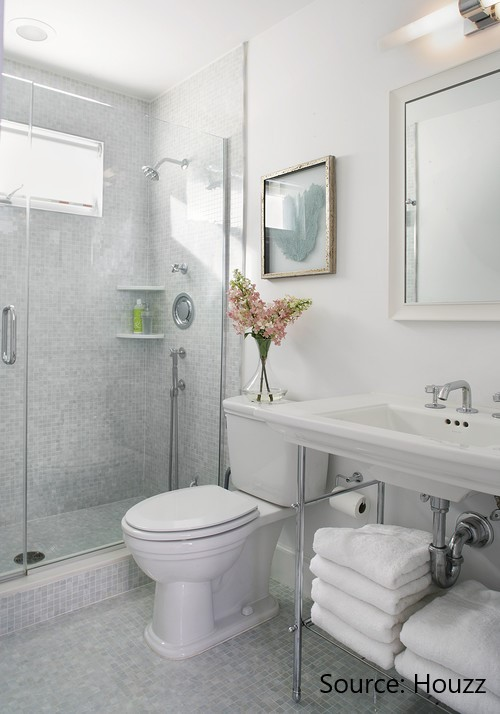 Bathroom with grey and white tiles for floor and shower