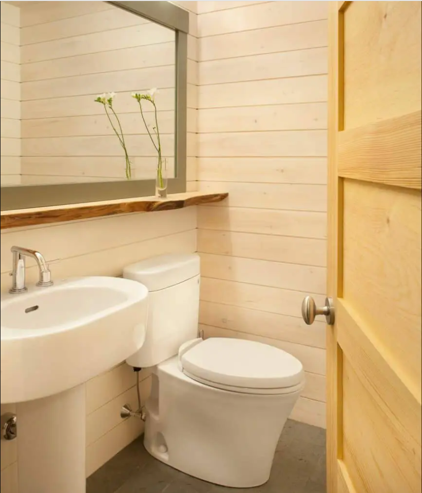 Small Bathroom with ledge over sink and toilet