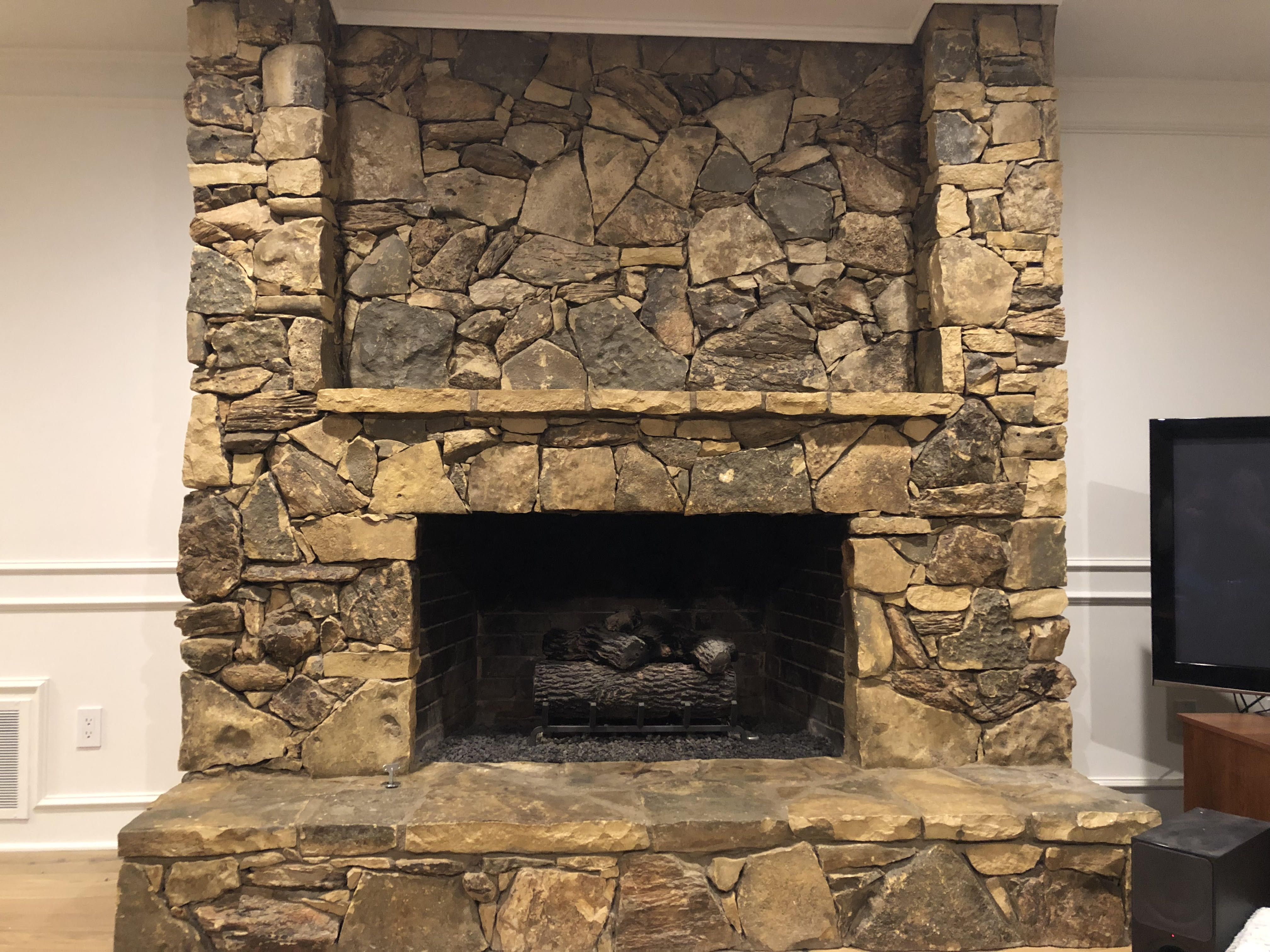 Natural stacked rock fireplace