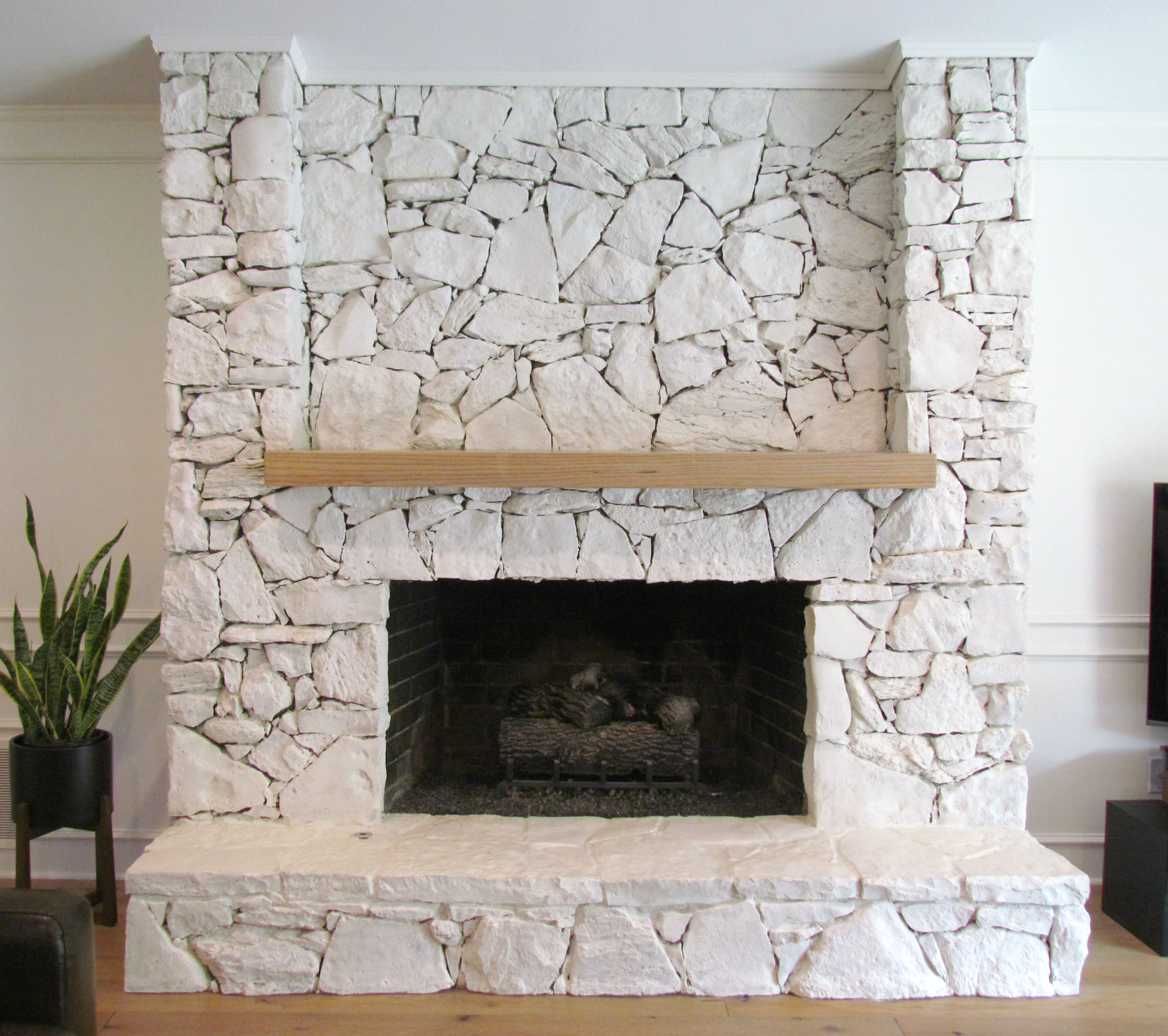 Natural stacked rock fireplace painted with limewash