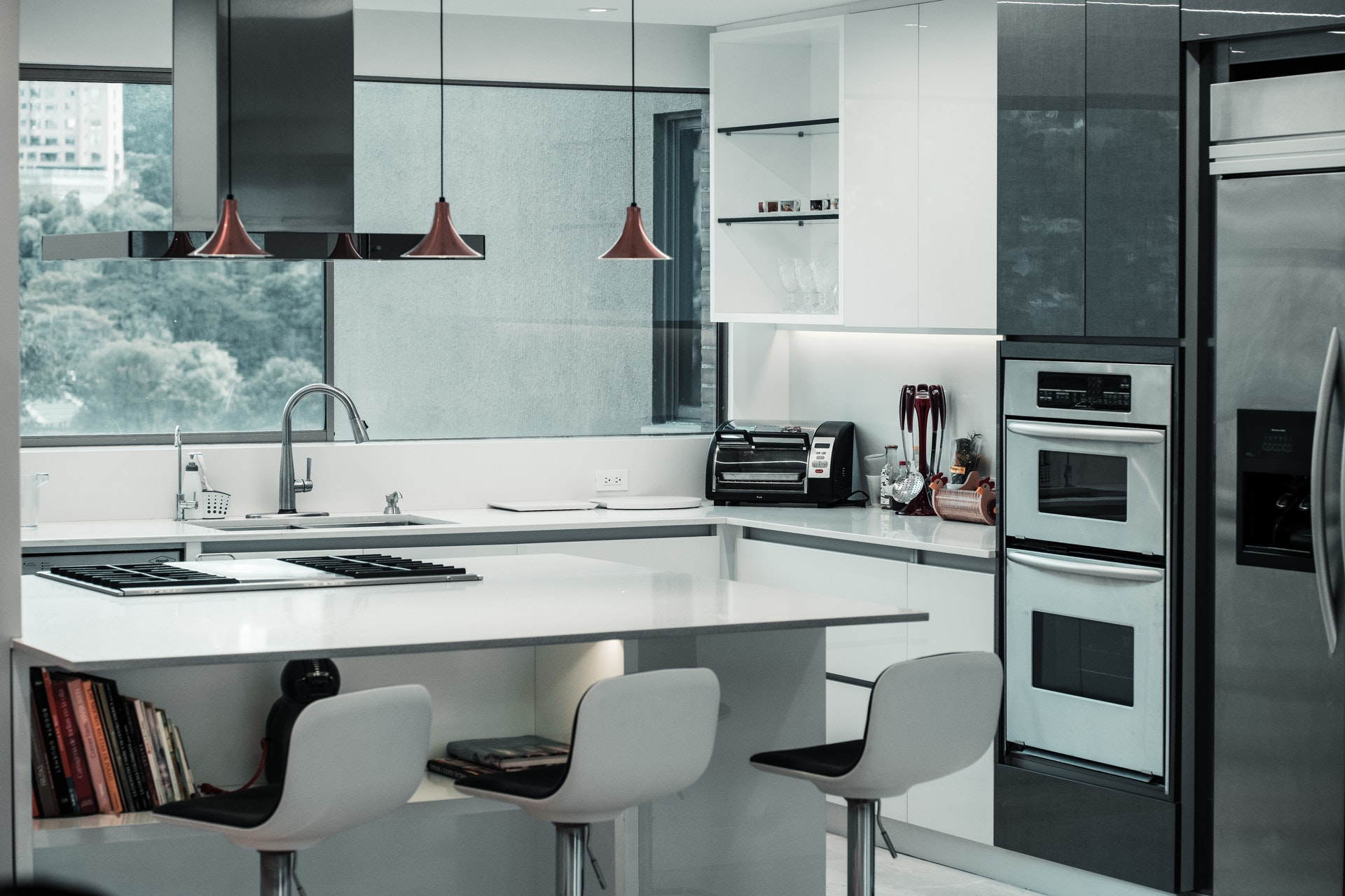 upscale modern kitchen with steel appliances