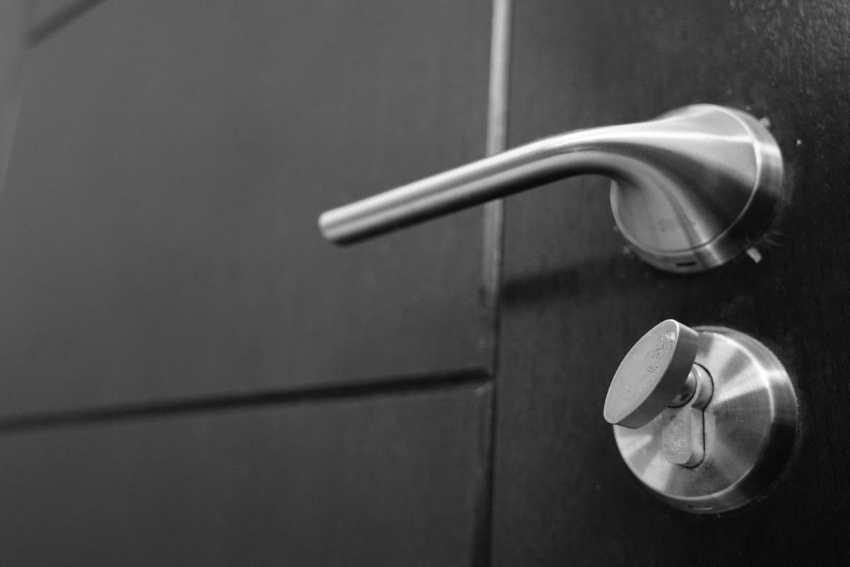 steel doorknob on black door