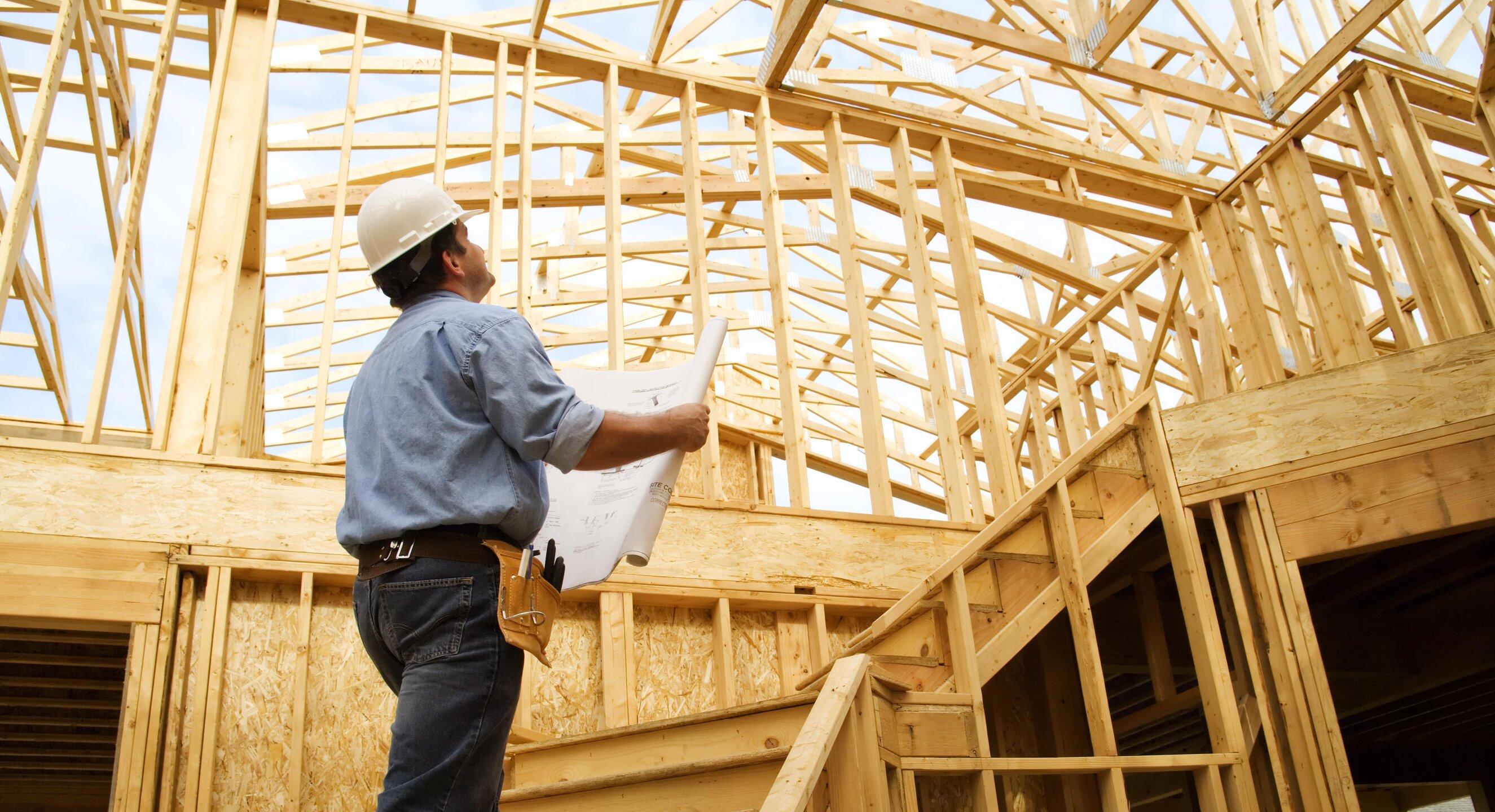 general contractor holding blueprints