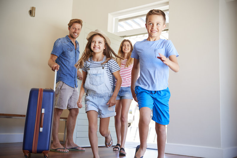 Family entering vacation home