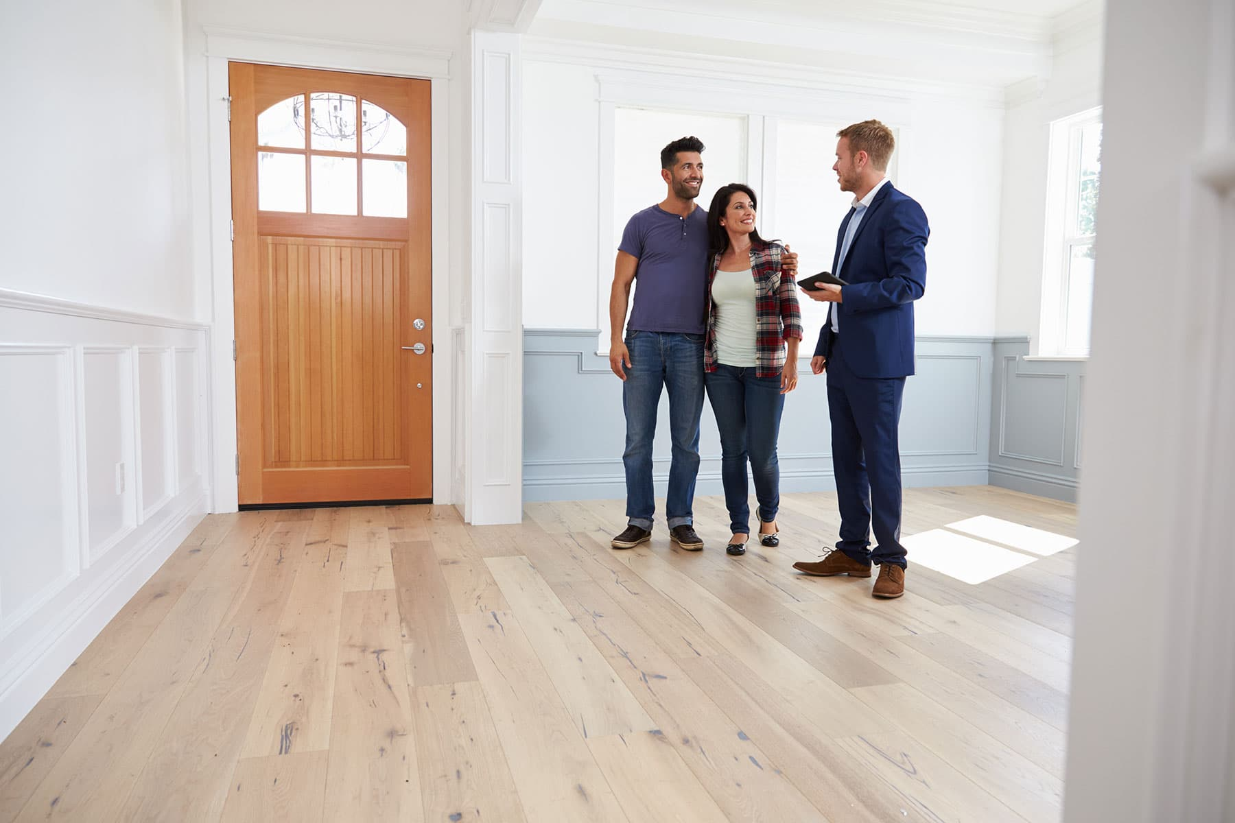 couple talking with real estate agent