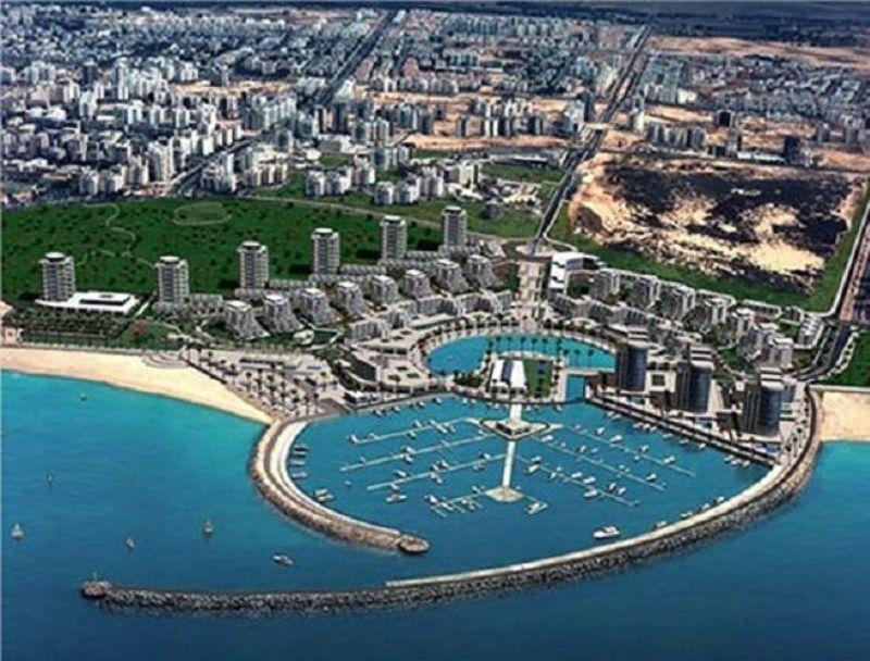 harbor with marina next to city
