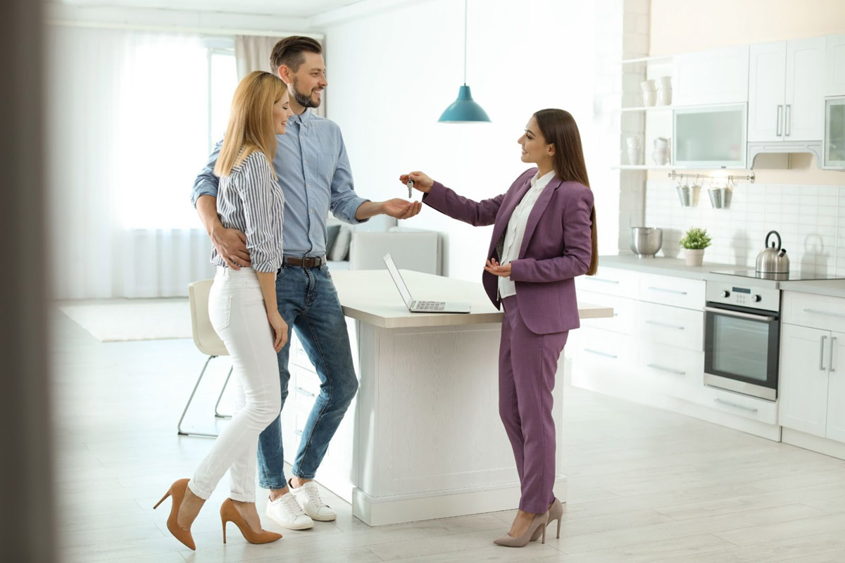 Real Estate Agent Helping Couple To Buy Their First Home In a Seller's Market