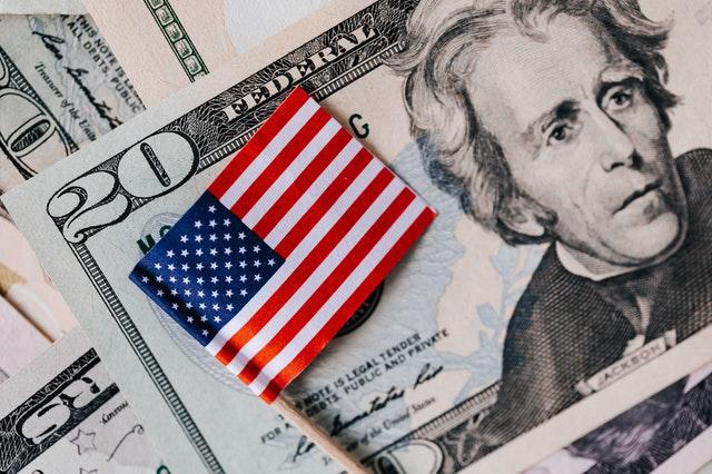 Twenty dollar bill with american flag