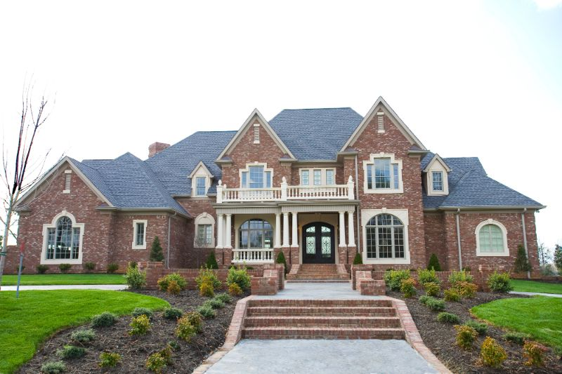 large brick house with balcony