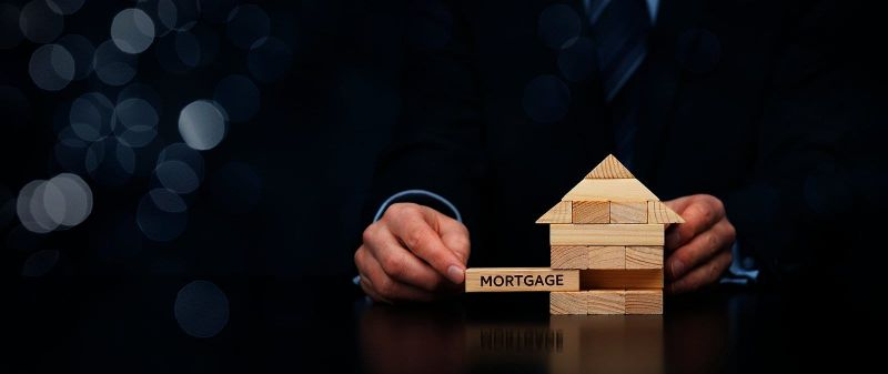 small jenga puzzle with mortgage block