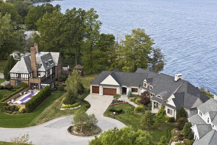 large house along side of lake