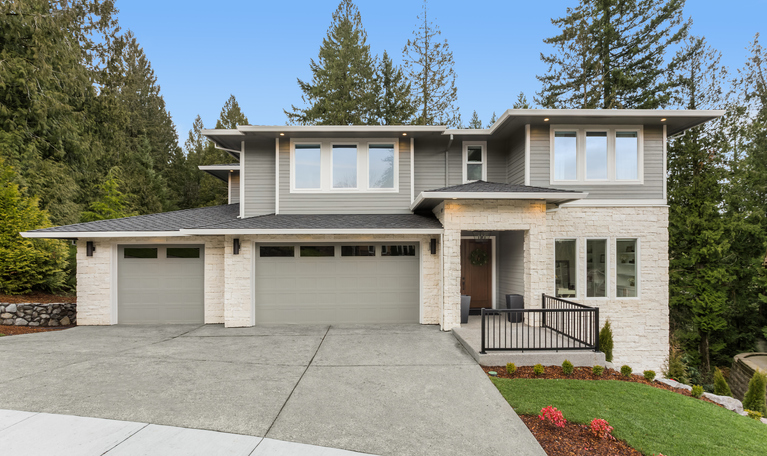 large 2-story contemporary home with driveway