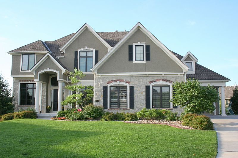 gray 2-story home with large front yard