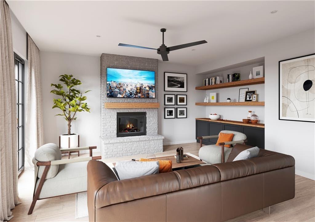 large living room with hardwood floors and bookshelf